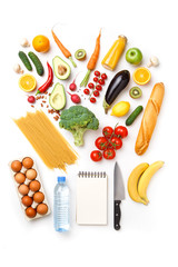 Photo of apples, oranges, pasta, broccoli, avocado, carrots, blank notebook, eggs, bottle of water, knife