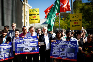 Jeremy Corbyn, the leader of Britain's Labour Party joins a demonstration demanding the re-nationalization of the railways, outside King's Cross station in London