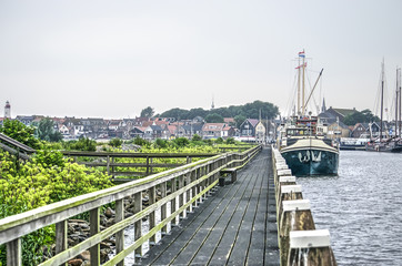 Wooden platforms and mooring in the harbour of the fishing-village of Urk, The Netherlands