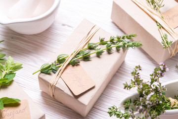 Gift box decorated with thyme branch