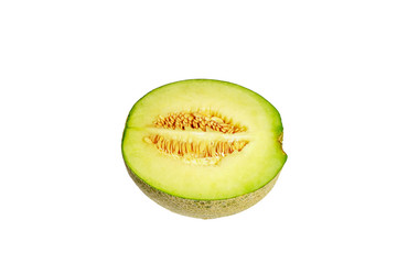 The green melon cut in half isolated on a white background.