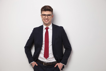 portrait of happy relaxed businessman with glasses standing