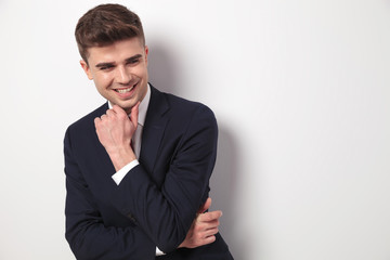joyful and pensive young businessman looks to side