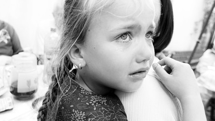 Offended girl cries. B/W photo