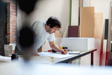 Carpenter working on new design