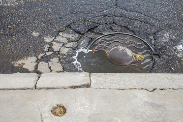 Manhole drain cover on streets of Moskow Russia.