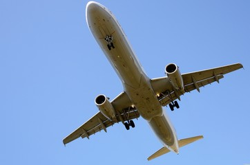 Plane flying over the blue sky. Concept of commercial travel airline