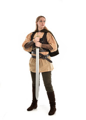 full length portrait of girl wearing brown medieval costume,. standing pose, isolated on white studio background.