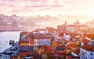 Fototapete - Antique town Porto, Portugal. Sunset sun over silhouettes