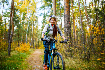 Photo of girl in helmet riding on bike