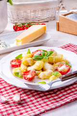 Foto op Canvas Assortiment delicious gnocchi with gorgonzola cream sauce and cherry tomatoes