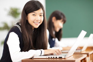 teenager student learning online with laptop in classroom