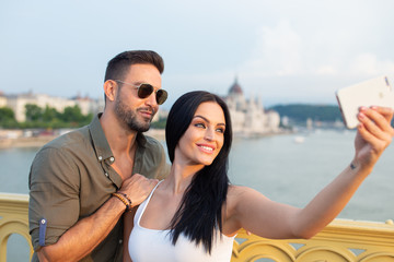 Happy young couple taking selfie at Budapest