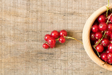 Fresh red berries on an old wooden table. Close up. Healthy eating concept