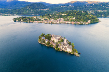 The very suggestive and romantic island of San Giulio in Orta lake, Piedmont, Italy. Aerial view.