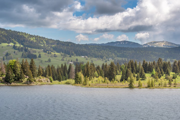 French landscape - Jura. View over the lake of Les Rousses in the Jura mountains (France) with the Mount La Dole (Switzerland) in the background.