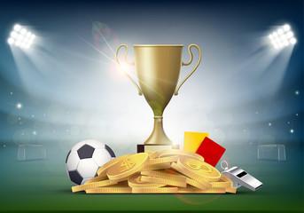 ลูกฟุตบอลพร้อมถ้วยและเหรียญทองบนสนามกีฬา