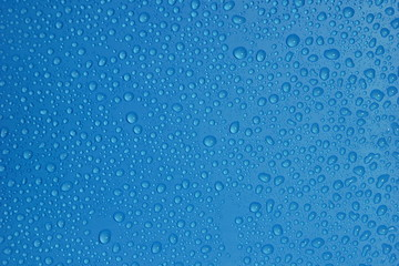 water drops blue color texture background close-up.