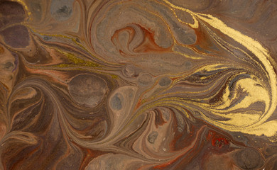 Marble abstract acrylic background. Marbling artwork texture. Agate ripple pattern. Gold powder.