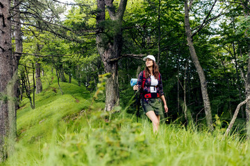 Female hiker with backpacks exploring nature