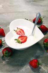 strawberry yogurt in bowl with fresh strawberries