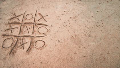 Tic-tac-toe on the sand.