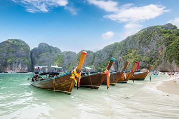 Wooden long-tail boats anchored on seashore at Maya bay
