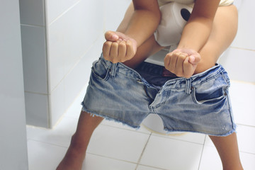 young woman has constipation or hemorrhoids sitting on toilet, Healthy concept