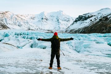 adventurous man walking on a glacier in iceland