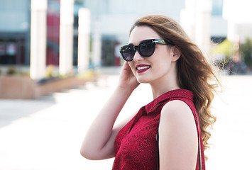 Young smiling woman wearing sunglasses