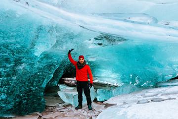 adventurous man walking on a glacier in iceland