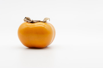 a lonely and ripe persimmon