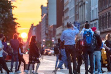 People standing in the middle of 23rd street photographing the sunset in Manhattan, New York City