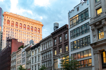 Historic buildings along 23rd Street in Manhattan New York City at dusk