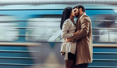 Young romantic couple in subway