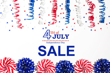 4th of July sale with holiday decorations on a white background flat lay