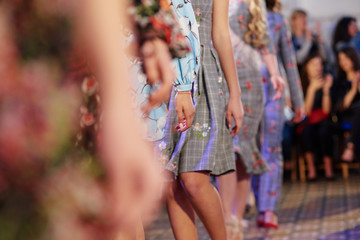Fashion models showing new clothes collection at fashion week