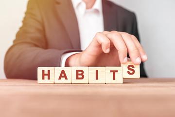 Man made word HABITS with wood blocks