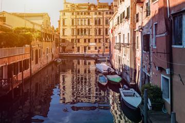 Streets of Venice, boats at sunset, cityscape Venice