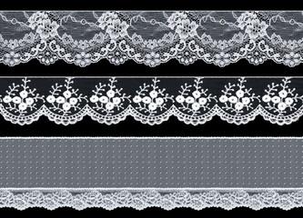 Set of three elegant white lace ribbons on a black background. Lace braid.