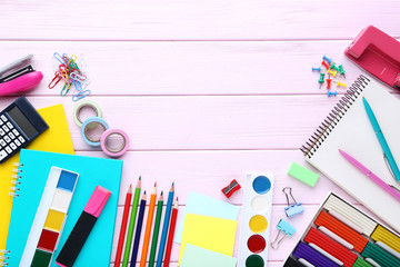 School supplies on pink wooden table