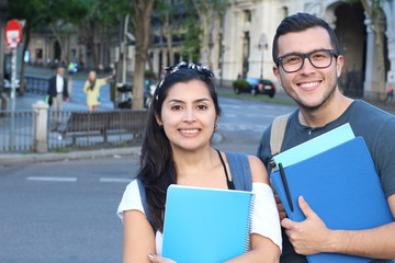Ecstatic couple of ethnic international students abroad