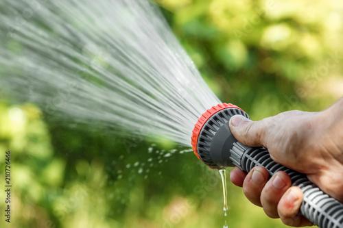 Men S Hand With Garden Hose Watering Plants Gardening