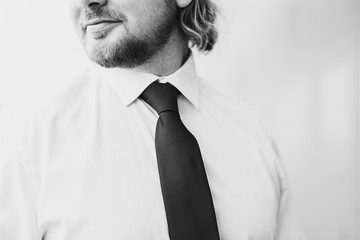 man wearing business outfit with tie and shirt and copyspace next to him