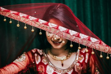 Woman wearing red at traditional Indian wedding