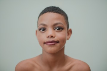 Androgynous boy in makeup