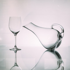 Set of empty glass wine decanter with a wine glass