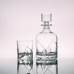 Set of empty glass decanter with a glass