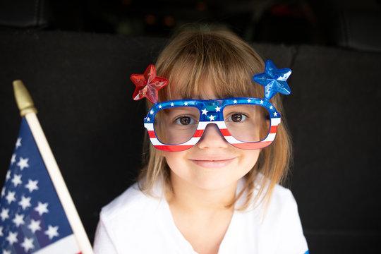 Girl wearing patriotic novelty glasses