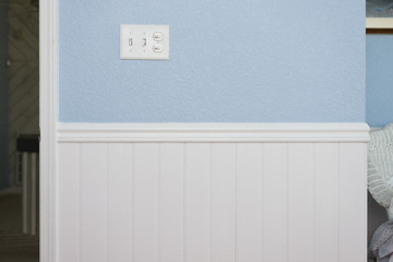 White beadboard or wainscoting with light blue wall paint